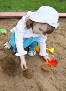 Free Little Cute Girl Plays In Sandbox Royalty Free Stock Photos - 25350938
