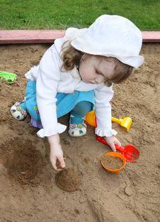 Little Cute Girl Plays In Sandbox Royalty Free Stock Photos
