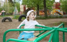 Free Pensive Little Girl Rides On Small Carousel Royalty Free Stock Photography - 25350967