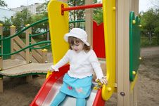 Free Cute Little Girl Prepares For Rolling At Slide Royalty Free Stock Photography - 25351017
