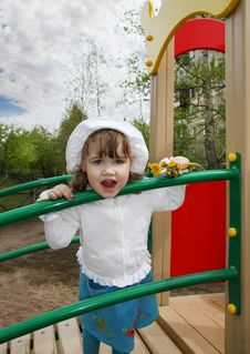 Cute Little Girl Stands On Playground Stock Images