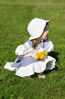 Free Beautiful Little Girl With Yellow Dandelions Stock Photography - 25351132