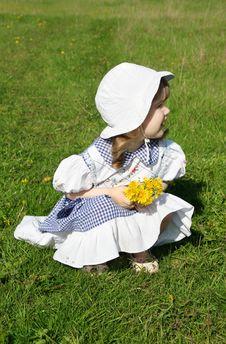 Beautiful Little Girl With Yellow Dandelions Stock Photography