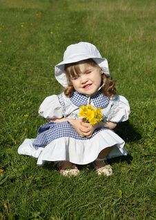 Free Little Girl With Yellow Dandelions Sits On Grass Royalty Free Stock Photography - 25351157