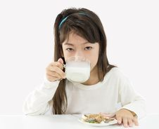 Free Cute Girl Drinking Milk Royalty Free Stock Image - 25358786