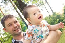 Free Young Father With A Charming Baby Royalty Free Stock Photos - 25364548