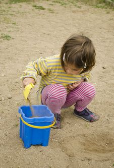 Free Child Playing In The Sand Stock Photo - 25371810