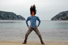 Man With Long Hair On The Beach Royalty Free Stock Photo