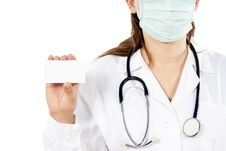 Free Doctor In A Mask Keeps A Business Card Royalty Free Stock Photos - 25386628