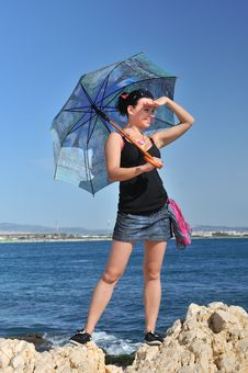 Free At Sea, Under The Umbrella Royalty Free Stock Image - 25388046