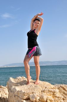 Free Dancing Girl On The Rocks Stock Photos - 25388453