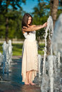 Free Beautiful Brunette Girl Playing At  Water Fountain Royalty Free Stock Images - 25395919