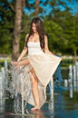 Free Beautiful Brunette Girl Playing At  Water Fountain Stock Photography - 25395992