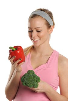 Free Young Woman Holding A Red Pepper And Broccoli Royalty Free Stock Photo - 25391675