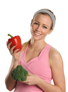 Free Young Woman Holding A Red Pepper And Broccoli Stock Photo - 25391680