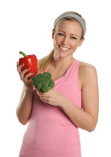 Free Young Woman Holding A Red Pepper And Broccoli Stock Photo - 25391690