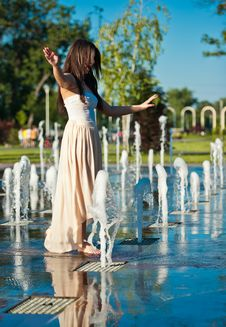 Free Beautiful Brunette Girl Playing At  Water Fountain Stock Image - 25395971