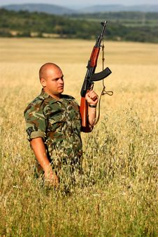 Soldier In A Field Stock Image