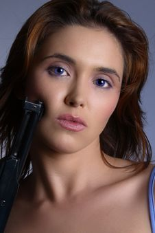 Blue Eyed Gun Royalty Free Stock Images
