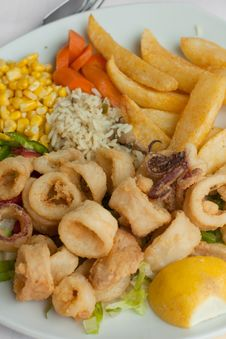 Fried Calamari With Vegetables Stock Photography