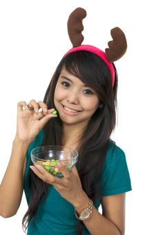 Free Santa Woman Eating Candy Stock Photo - 25411500