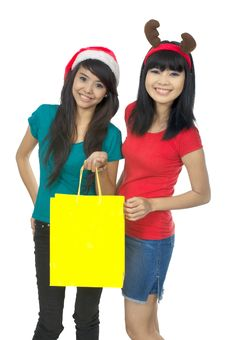 Free Two Woman Shopping For Christmas Royalty Free Stock Photo - 25411585