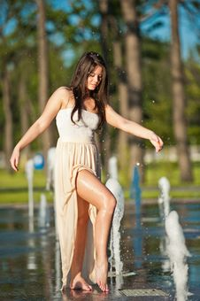 Girl Playing At Outdoor Water Fountain Stock Image
