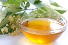 Golden Honey In A Transparent Bowl Stock Photo
