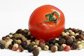 Free Cherry Tomato On Peppercorns Royalty Free Stock Image - 25437016