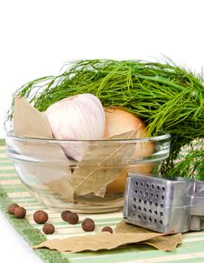 Dill Lies On A Garlic And Onion In A Dish Stock Photo