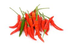 One Green Between Red Chili Peppers Stock Photo