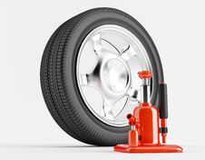 Free Wheel And Car Jack Royalty Free Stock Image - 25466186
