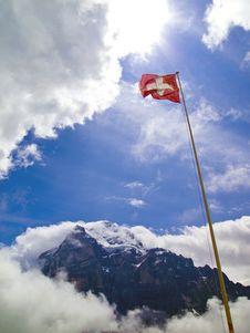 A National Flag Of Switzerland With Mt.Wetterhorn Stock Photos