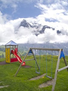 Free Playground With Swiss Alps Background Stock Photos - 25466293