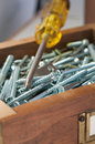Free Screws And Philips Screwdriver Royalty Free Stock Image - 25471736