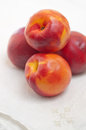 Free Four Nectarines And Embroidered Napkin Stock Photo - 25487660
