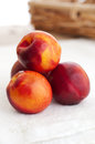 Free Four Nectarines And Embroidered Napkin Royalty Free Stock Photography - 25487667