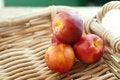 Free Four Nectarines In Basket Royalty Free Stock Photos - 25487678