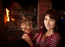 Free Woman With A Glass Of Wine Near The Fireplace Stock Image - 25481191