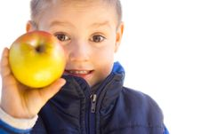 Free Little Boy Holding  Apple Royalty Free Stock Photo - 25485665