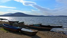 Free Boats On The Shore Against The Backdrop Of The Lak Royalty Free Stock Photo - 25494375