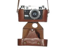 Free Classic Vintage Camera In A Leather Cover Royalty Free Stock Photography - 25505027