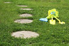 Free Kids Gardening Kit In A Backyard Garden Stock Photo - 25509140