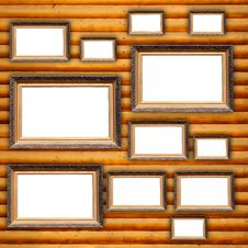 Free Blank Picture Frames On Wooden Wall Royalty Free Stock Photography - 25516627