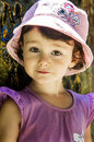 Free Small Girl In Pink Hat Leaning Against A Wall Royalty Free Stock Image - 25529936
