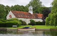 Free Medieval Riverside Building With Moored Boat Stock Image - 25536341