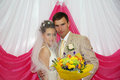 Free Happy Groom With Flowers Hugs His Bride Royalty Free Stock Photo - 25541105