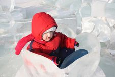 Free Little Girl Sits In Ice Nenuphar At Winter Royalty Free Stock Photo - 25540875