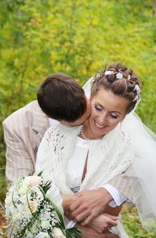 Free Groom Hugs His Bride With Roses And Kisses Neck Royalty Free Stock Photo - 25541045