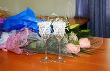 Two Decorated Wedding Glasses And Flowers